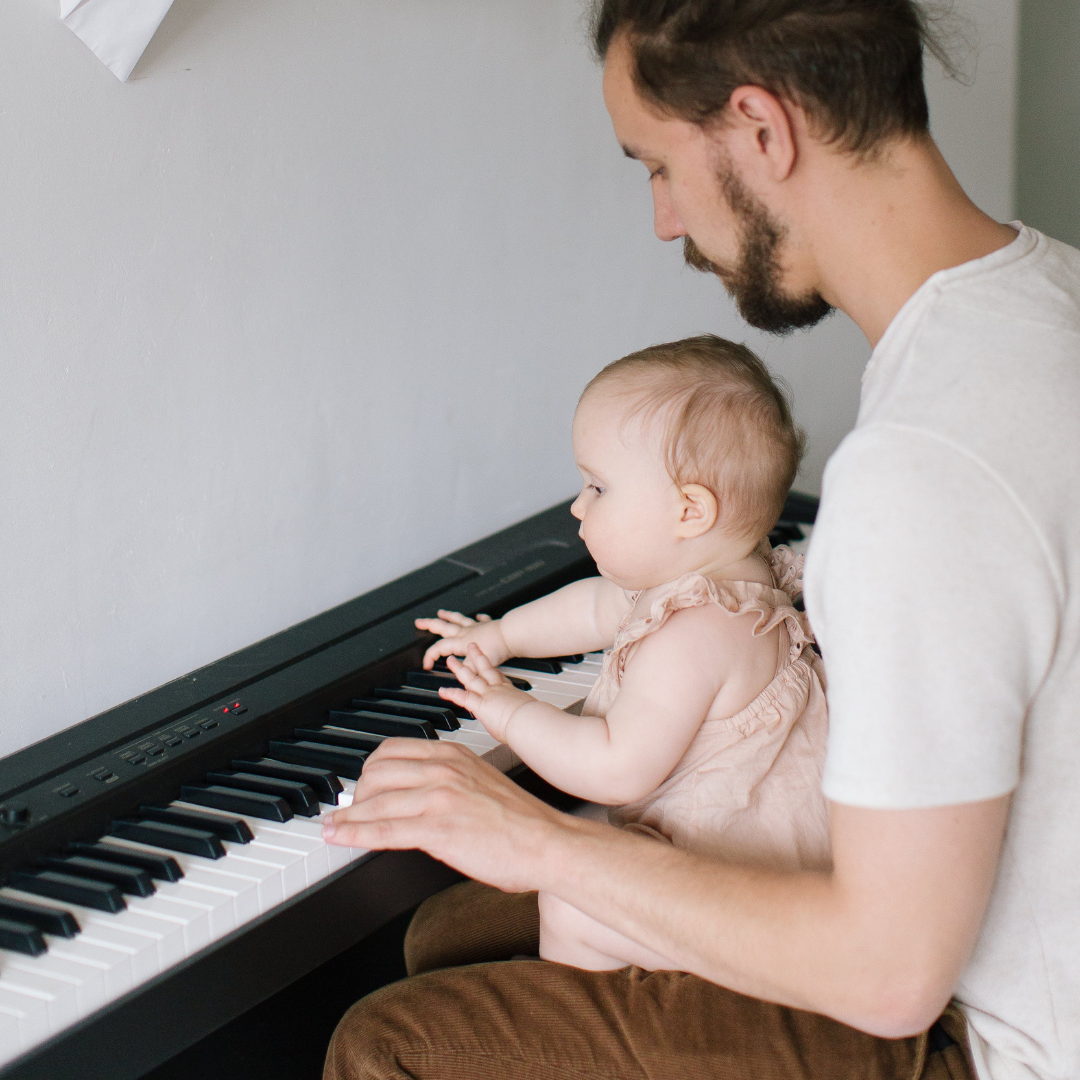 Music. Therapy. Baby. Infant. Dad Playing the Piano. Find Your Voice Music Therapy.